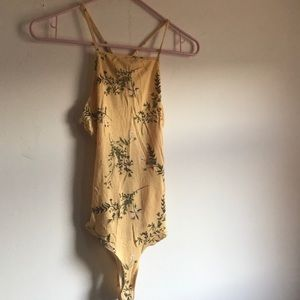 Yellow high neck body suit